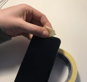 use adhesive tape to clean iphone speaker